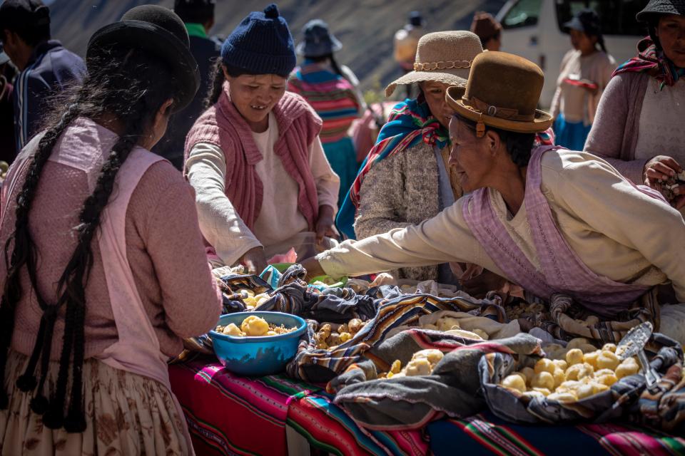 Bolivian women preparing food for a market